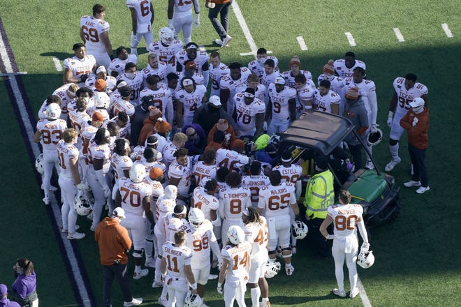 Members of the Texas football team Derek Kerstetter after the offensive lineman dislocated his ankle during a 69-31 win over Kansas State in Manhattan, Kan., on Dec. 5, 2020.