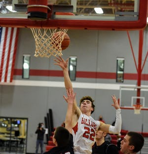 Ashton Hermann scored 20 points and hit two clutch free throws in overtime to help the Ballard boys hold off Adel-Desoto-Minburn, 59-55, Friday in Huxley.