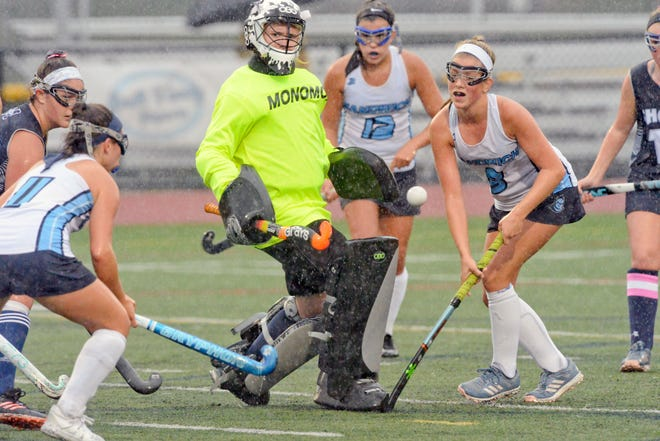 Monomoy senior goalie Caitlin Bouvier, center, will continue her field hockey career next year at Division III St. Joseph's College of Maine.
