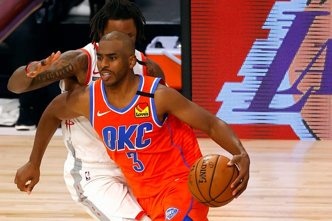 Oklahoma City Thunder's Chris Paul drives against the Houston Rockets during Game 3 of a first-round playoff series in Lake Buena Vista, Fla.