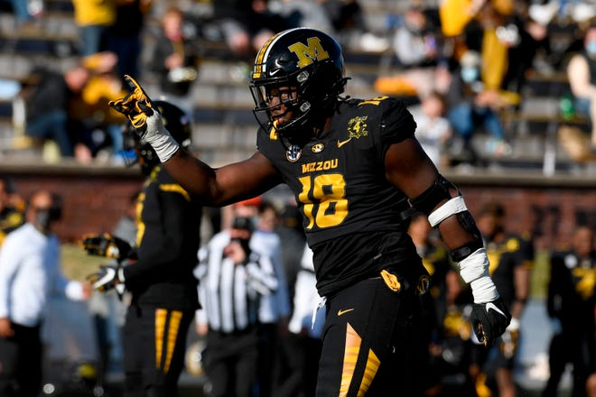 Missouri's Trajan Jeffcoat celebrates during a game against Arkansas on Saturday at Faurot Field.