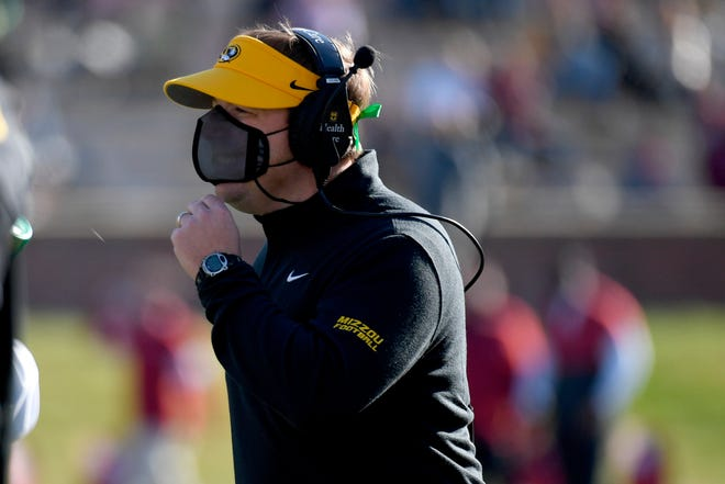 Missouri head football coach Eli Drinkwitz watches from the sidelines during a game against Arkansas on Dec. 5 at Faurot Field.