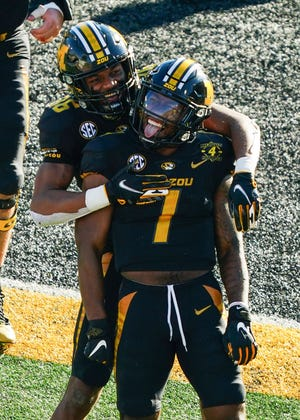Missouri running back Tyler Badie (1) celebrates with wide receiver Tauskie Dove (86) after scoring a touchdown against Arkansas during a game Saturday at Faurot Field.