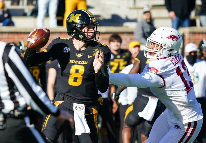 Missouri quarterback Connor Bazelak (8) drops back to pass against Arkansas during a game last season at Faurot Field.
