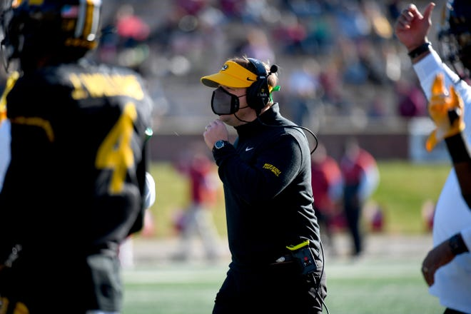Missouri head coach Eli Drinkwitz watches from the sidelines during the second half of Missouri's 50-48 win over Arkansas on Saturday at Faurot Field.