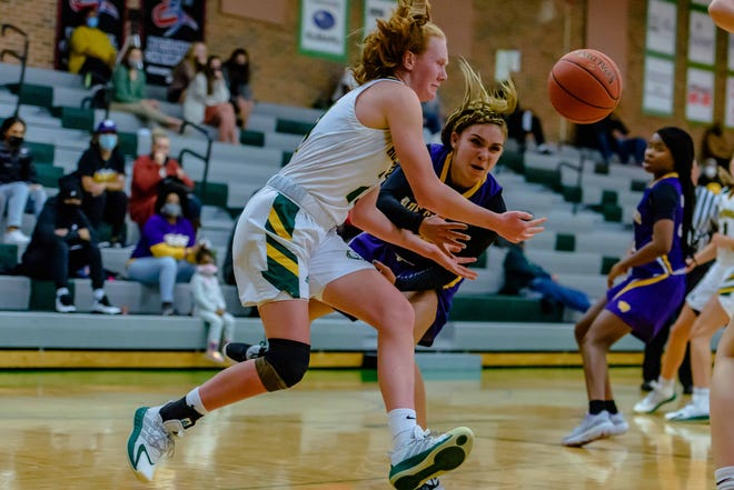 Blue Springs' Jada Williams tips the ball away from Rock Bridge's Averi Kroenke, front, during a game Friday night at Rock Bridge High School.