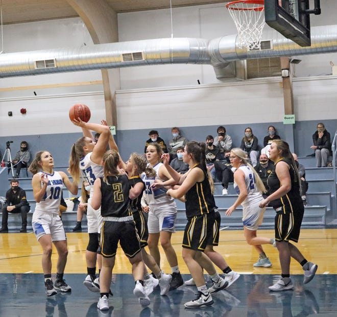 Kailey Hulett of Southwest Livingston's Lady Wildcats prepares to hit a first-quarter putback over multiple Orrick defenders during Thursday's 2020-21 high school basketball season and home opener for SLHS. Hulett scored six points as the Lady Wildcats crushed OHS 46-9.