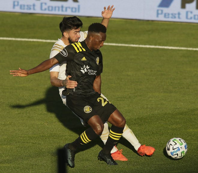 Crew defender Harrison Afful (25) is defended by Atlanta United midfielder Marcelino Moreno during a playoff game at Mapfre Stadium on Nov. 8.