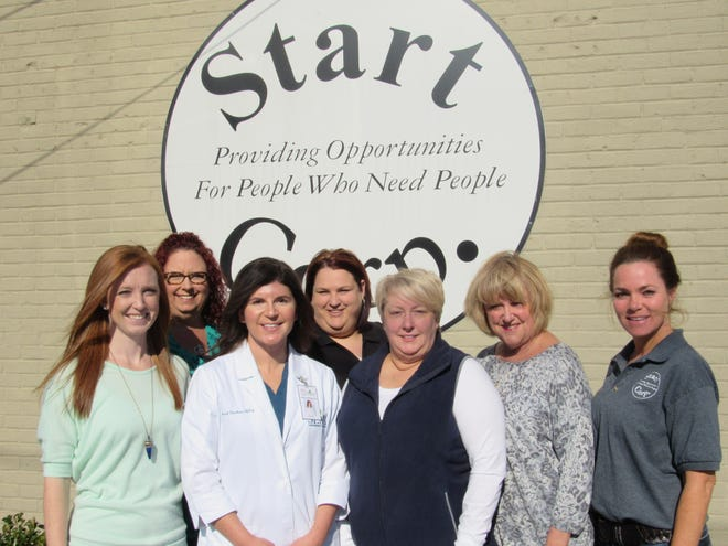 Staff members of the Start Corporation pose outside its Opportunity Center in Houma.