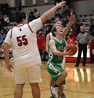 Barnesville's  Jeremy Hunkler (23) gets past a pair of St. Clairsville defenders during Friday night's game at St. Clairsville High School.