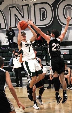 Shenandoah's Christian Duniver (1) shoots the ball over Carrollton's Gage Poole (23) during Friday night's match-up at Shenandoah High School. Duniver tallied a game-high 24 points to lead the Zeps 53-48 victory.
