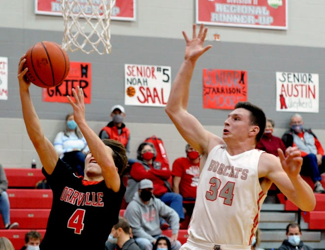 Jacob Rupp tries to track down Orrville's Daniel Malcuit during Norwayne's 70-47 win. Rupp wasn't successful on this attempt, but finished with three blocks on the night.