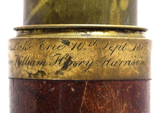 An engraving on the telescope that belonged to both Oliver Hazard Perry and William Henry Harrison. The telescope recently was sold for $99,000 at auction.