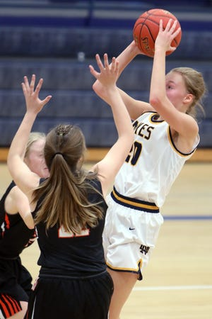 Notre Dame High School's Kathryn Stephens (20) shoots the ball during their game against Van Buren High School, Friday, Dec. 4, at Notre Dame's Father Minett gymnasium.