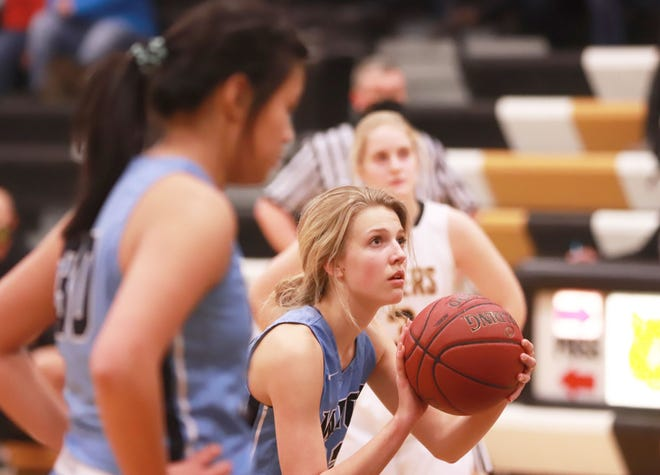 WACO's Ellah Kissell gets ready to shoot a free throw in their win over New London Friday at New London.