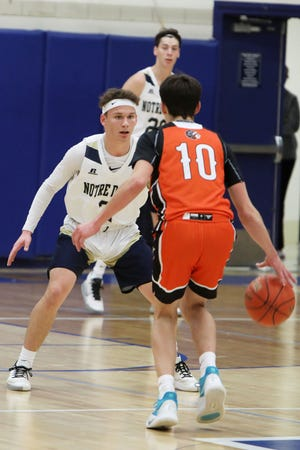 Notre Dame High School's Matt Johnson (3) guards Jackson Manning (10) during their game against Van Buren High School, Friday Dec. 4, 2020 at Notre Dame's Father Minett gymnasium.