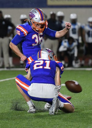Bolles kicker Parsa Pordeli (36) kicks the game winning field goal in overtime to defeat Gadsden County 10-7.