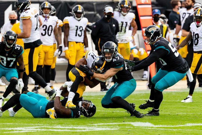 Jaguars linebacker Joe Schobert wraps up Pittsburgh ball carrier Ray-Ray McCloud during last week's game at TIAA Bank Field. Matt Pendleton/Special to Times-Union