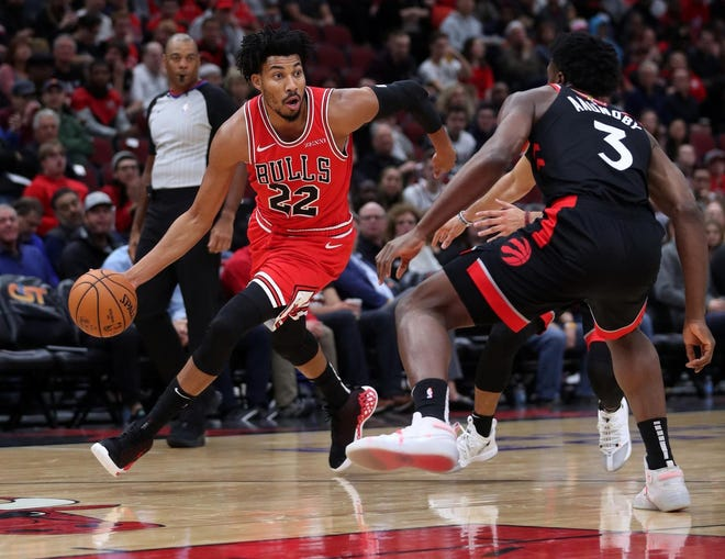 Chicago Bulls forward Otto Porter Jr. drives on Toronto Raptors forward OG Anunoby in the first half of the Bulls' home opener at the United Center in Chicago on Saturday, Oct. 26, 2019.