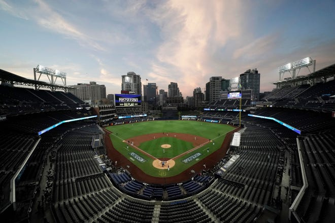 The Tampa Bay Rays and the New York Yankees play in Game 2 of the AL Division Series on Oct. 6 in an empty Petco Park in San Diego. Major League Baseball and all 30 of its teams are suing their insurance providers, citing billions of dollars in losses during the 2020 season played almost entirely without fans due to the coronavirus pandemic. [AP Photo/Jae C. Hong]