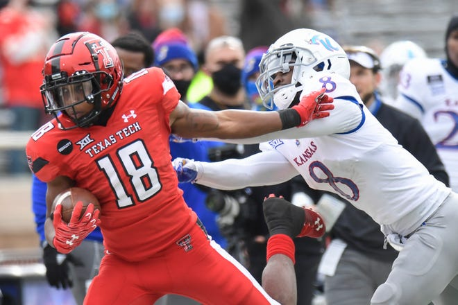 Texas Tech inside receiver Myles Price (18) is shoved out of bounds by Kansas defensive back Kyle Mayberry during the Red Raiders' 16-13 victory last year. Price had a 70-yard touchdown run in that game. The two teams play again Saturday at Kansas.