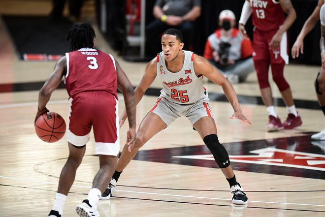 Texas Tech's Nimari Burnett (25) guards Troy's Kam Woods (3) during a nonconference game Friday inside the United Supermarkets Arena. Burnett, a freshman and the Red Raiders first-ever McDonald's All-American, elected to leave the program Thursday. [Justin Rex/For A-J Media]