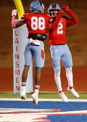 Monterey's De'onte Vaughn (88) and MJ Singleton (2) celebrate a touchdown during the first half of a District 2-5A, Division I playoff game Dec. 4 against Palo Duro at PlainsCapital Park at Lowrey Field.