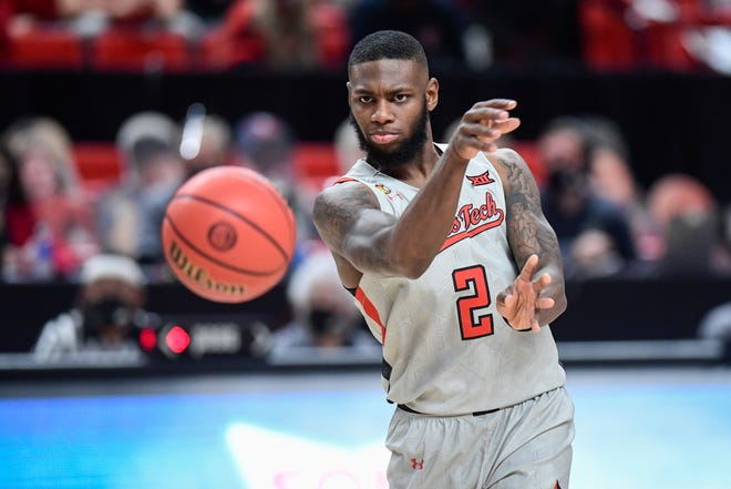 Texas Tech guard Jamarius Burton (2) passes the ball during the Red Raiders' 80-46 victory Friday against Troy. Tech (4-1) is ranked No. 17 in both The Associated Press Top 25 and in the coaches' poll this week.