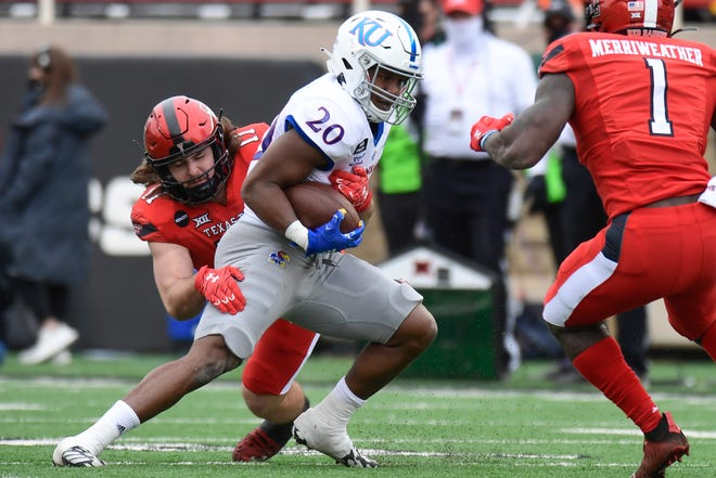 Texas Tech linebackers Colin Schooler, rear, and Krishon Merriweather (1) converge on Kansas running back Daniel Hishaw during the Red Raiders' 16-13 victory Saturday at Jones AT&T Stadium. Hishaw carried 22 times for 87 yards, and the Red Raiders held the Jayhawks to 214 yards of total offense.