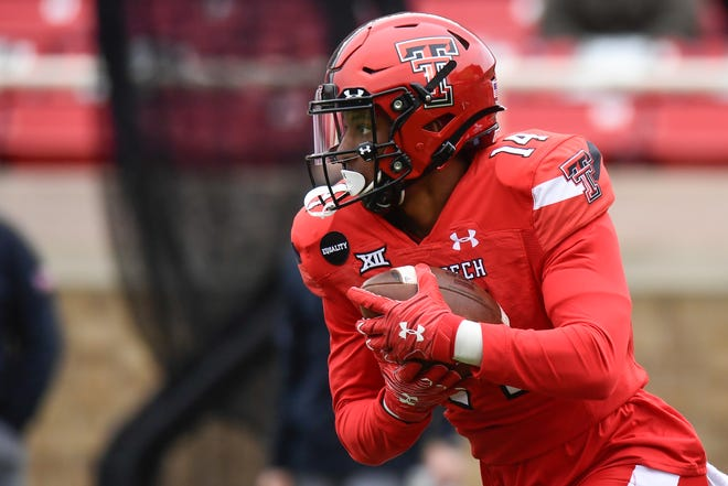 Xavier White (14) was Texas Tech's second-leading rusher last season with 436 yards, but arthroscopic shoulder surgery in the offseason has him down for spring practice. White is one of a half dozen Tech players who are out or limited in March and April after shoulder surgeries.