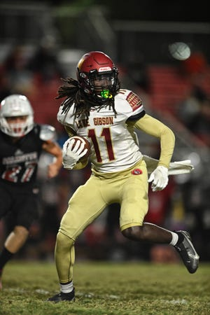 Lake Gibson wide receiver Sam McCall looks to make a move against Palmetto on Friday night in the Class 6A, Region 3 final.