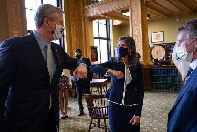 Gov. Charlie Baker congratulates the state Supreme Judicial Court's newest justice, Dalila Argaez Wendlandt.