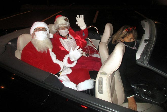 Hamilton mayor RuthAnn Loveless drives Santa and Mrs. Claus as they set out to visit the young and young at heart Dec. 4 in Hamilton.