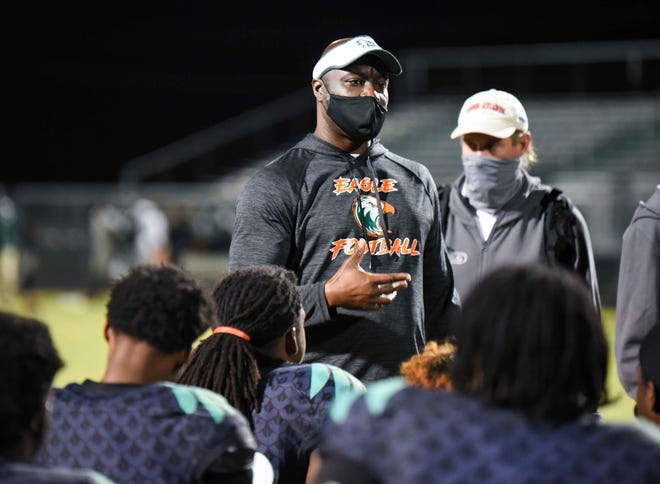 Atlantic head coach TJ Jackson talks to the team after the end of the second half of the Class 7A gold bracket quarter final game between Atlantic and North Miami in Delray Beach, FL, on Friday, December 4, 2020. Final score, Atlantic, 54, North Miami, 7.