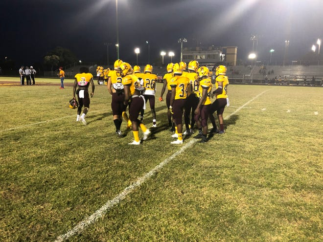 Glades Central warms up before Friday's tri-county playoff game against Booker T. Washington in Belle Glade.