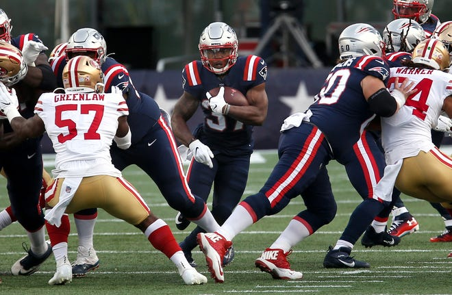 Patriots running back Damien Harris break through an opening in the first quarter of a game against the 49ers earlier this year.