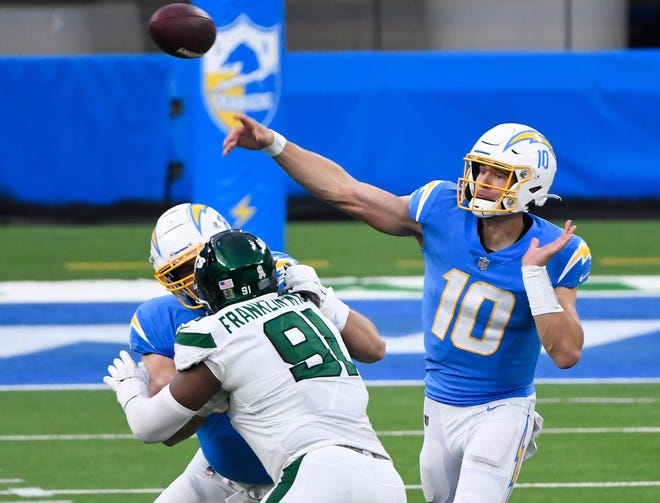 Los Angeles Chargers quarterback Justin Herbert (10) is on pace to break Cam Newton's NFL rookie record of 4,051 passing yards in a season.