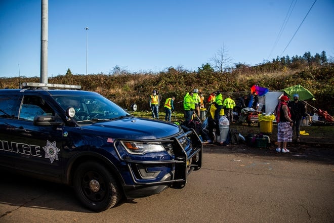 The city of Eugene cleared a camp displacing many homeless people, despite CDC guidelines, on Wednesday, Dec 2. Officers from the Eugene Police Department monitored as city staff cleared the area.