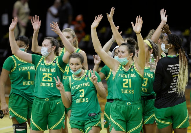 The Oregon women's basketball team waves to the TV audience after its game against Colorado to start the Pac12 season.