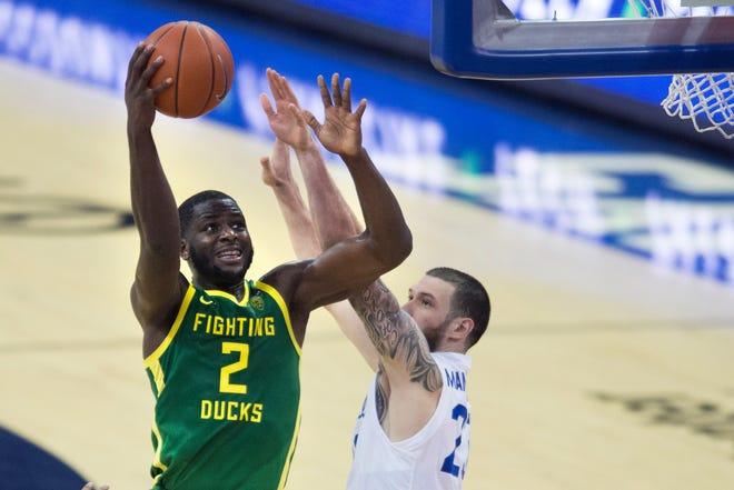 Oregon's Eugene Omoruyi shoots over Seton Hall's Sandro Mamukelashvili during the second half on Friday. (AP Photo/Kayla Wolf)