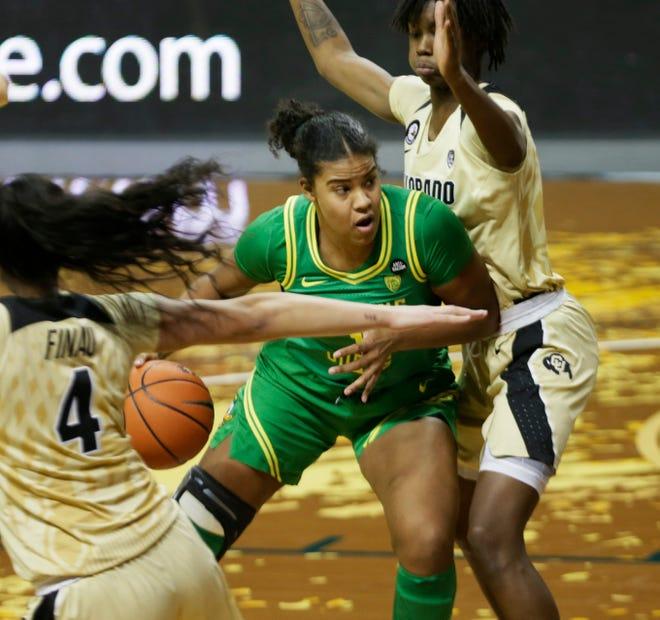 Oregon's Nyara Sabally, center, works for position under the basket against Colorado during the third quarter.