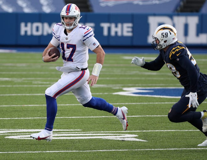 Buffalo quarterback Josh Allen (17), seen here trying to get past Los Angeles Chargers linebacker Nick Vigil during the Bills' 27-17 win on Nov. 29, leads the Bills against San Francisco on Monday night.