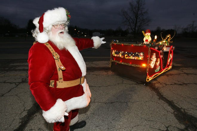 """As he toured communities south of Canton as Santa, the back of Charles """"Chuck"""" Tubbs' sleigh wished all those who saw it pass a very """"Merry Christmas."""""""