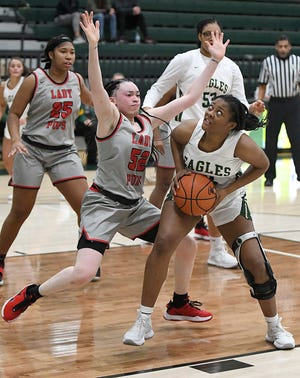 GlenOak's Aniyah Hall (right), shown against here against McKinley earlier this season, scored the winning basket in Saturday's 47-45 win over Hoover.