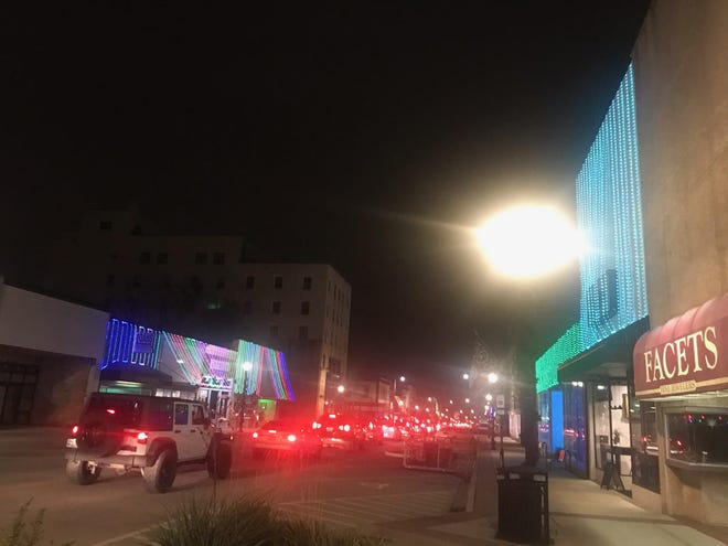 Cars head down Main Street for a World of Lights exhibit on Main Street Thursday night.