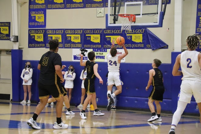 Bethel's Gage Porter scores two points in the second half of play against the visiting Tecumseh Savages Friday night.