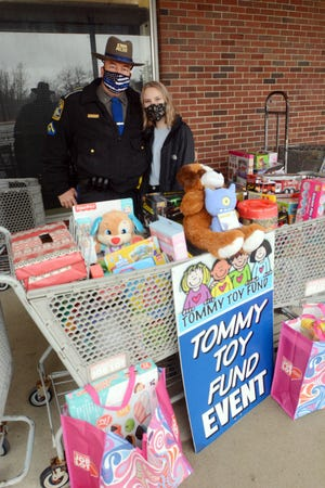Danielson State Trooper PFC Howard Smith, with his daughter Megan Smith, 14, both helped collect toys for the Tommy Toy Fund Saturday at Ocean State Job Lot in Brooklyn. This will be Smith's last year with Tommy Toy Fund as is retiring after 12 years of helping collect toys for the fund. See more photos at NorwichBulletin.com [John Shishmanian/ NorwichBulletin.com]