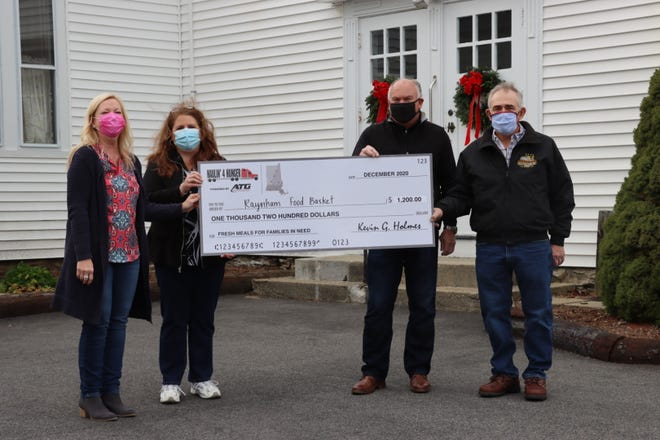 From left, Raynham Food Basket volunteers Lisa Mitchell and Paula Hardy accept a $1,200 donation from Advantage Truck Group's Haulin' 4 Hunger program, presented by Kevin Holmes, Advantage TruckGroup president & CEO, and Haulin' 4 Hunger sponsor Gil Lopes, president of G. Lopes Construction on Dec. 1.