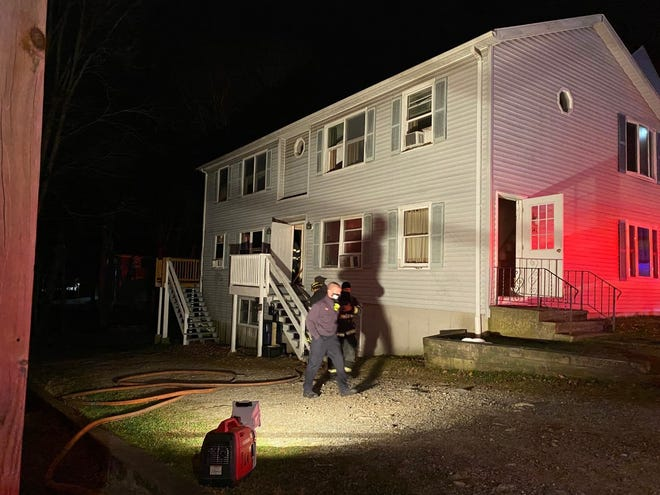 Fire investigators at the scene of a fire in a four-family apartment building in Worcester on Friday night.