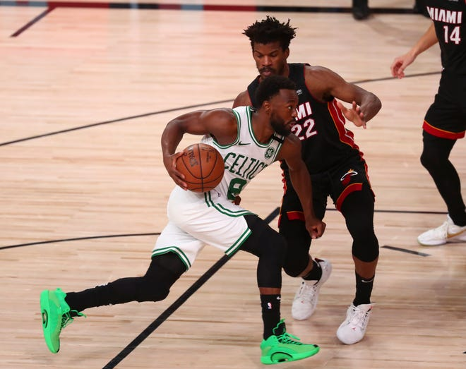 Celtics guard Kemba Walker drives to the basket defended by Heat forward Jimmy Butler during the 2020 NBA playoffs.